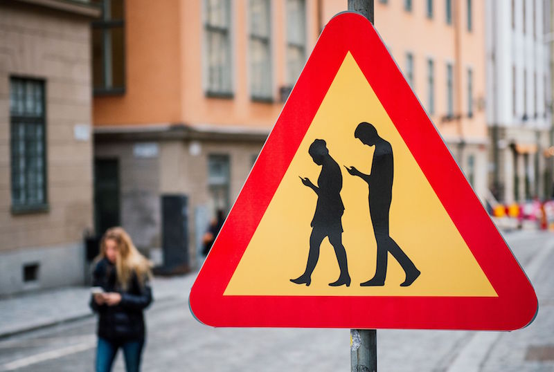 smartphone crossing sign