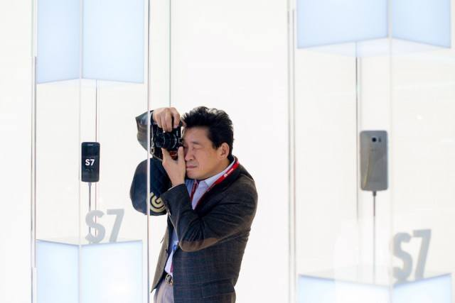 Man taking a picture of smartphones