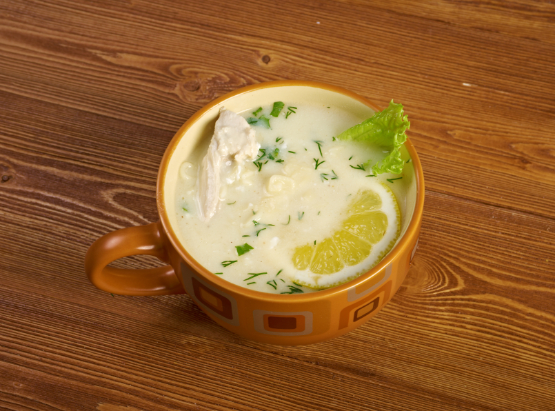 Avgolemono, a type of greek lemon and egg soup with chcien in a muge
