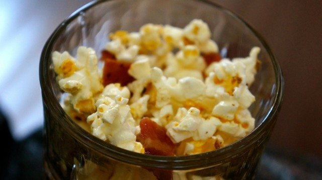 bowl of popcorn filled with bacon and cheese