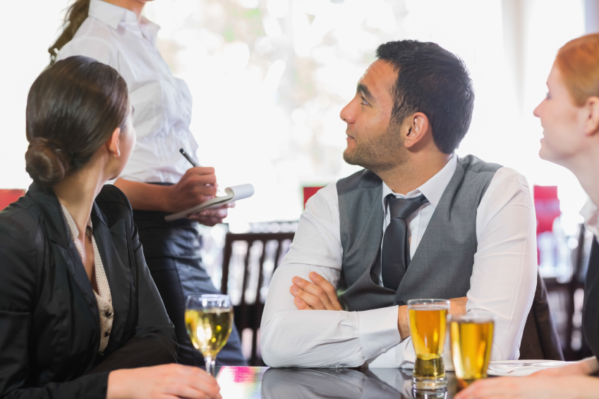 Business associates discuss options with their server