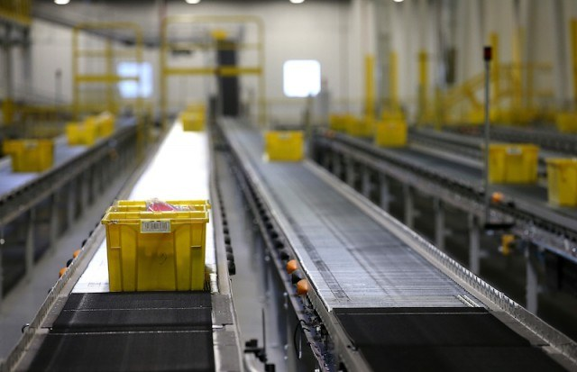 Boxes moving on a conveyor belt.