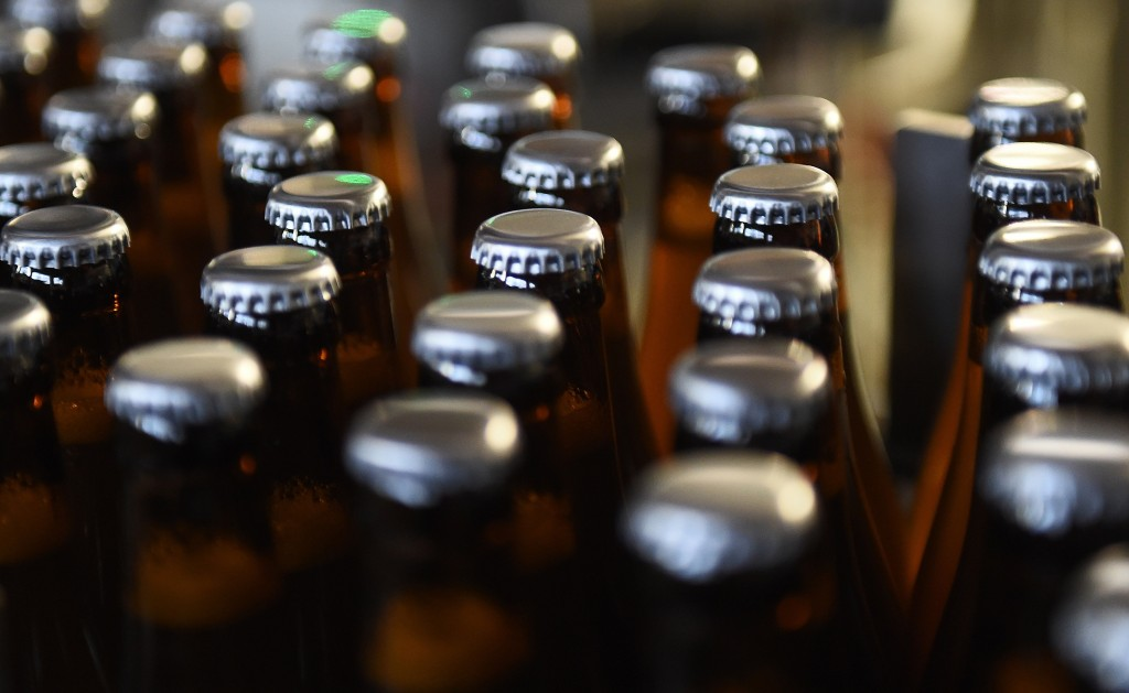 beer bottles in assembly line