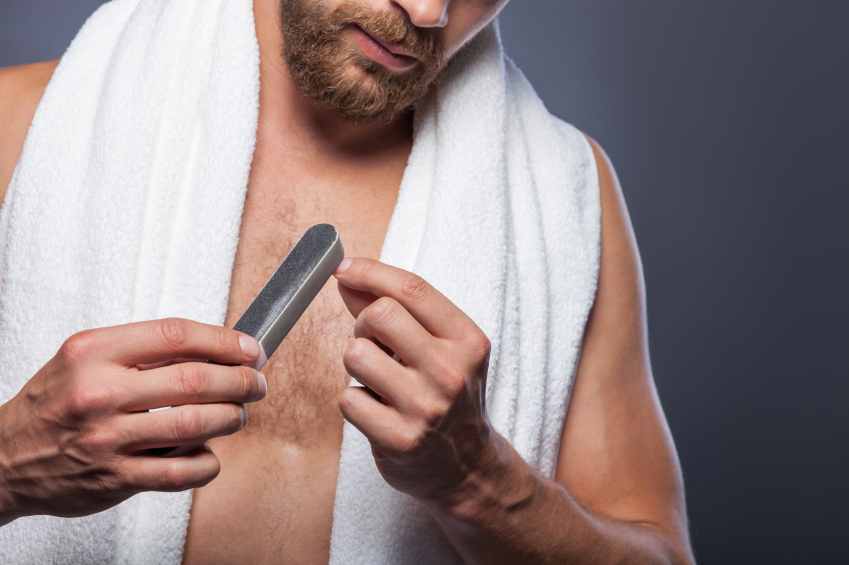 A man filing his nails