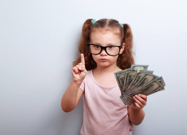 Little girl holding cash