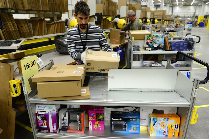 Amazon warehouse workers pick orders