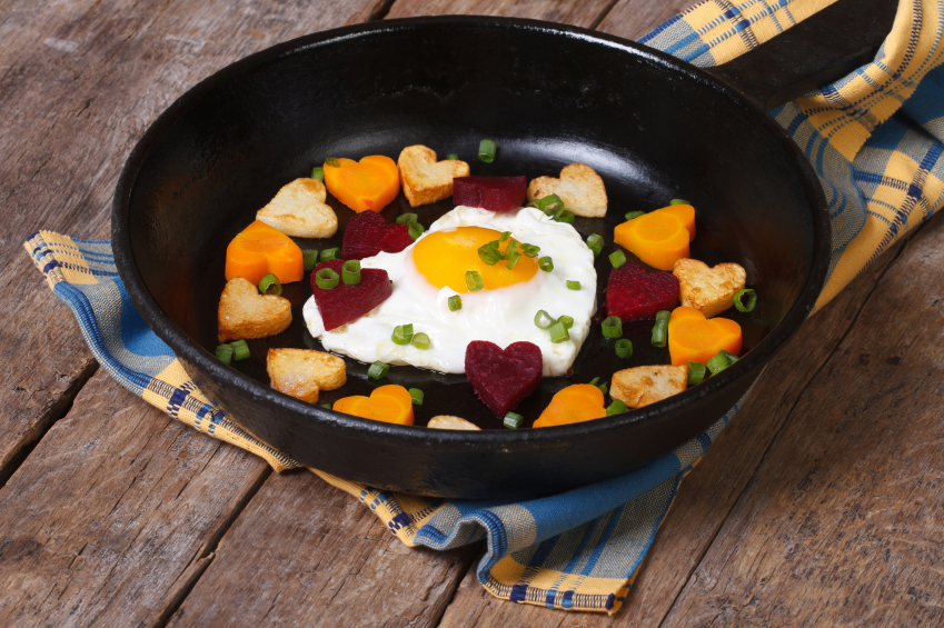 hash with heart-shaped carrots, potatoes, and beets with a fried egg