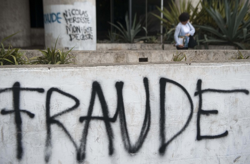 "Graffiti saying ""fraude"" is seen in Venezuela"