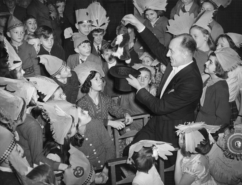 Magician pulling a rabbit from a hat