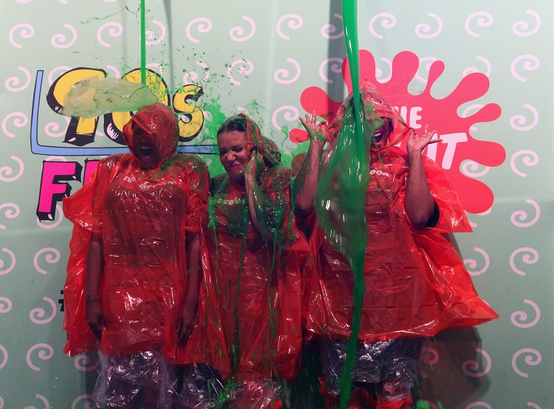 Millennials getting slime dumped on them on a gameshow
