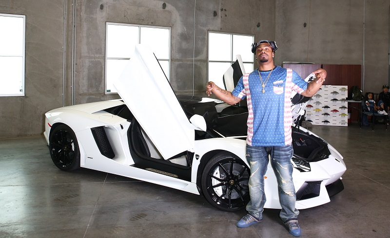 Marshawn Lynch with his Lamborghini
