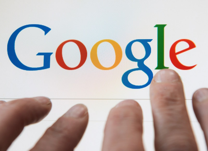 These fingers grasping for the Google logo remind that internet addiction is real