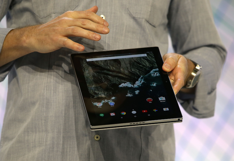A developer working on a tablet