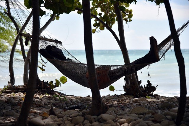 Man relaxing in a hammock in Haiti