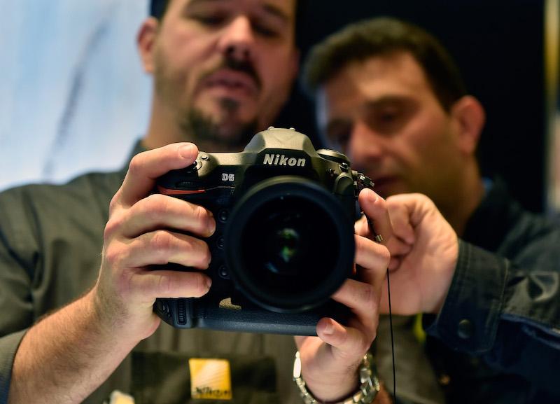 two men looking at a camera