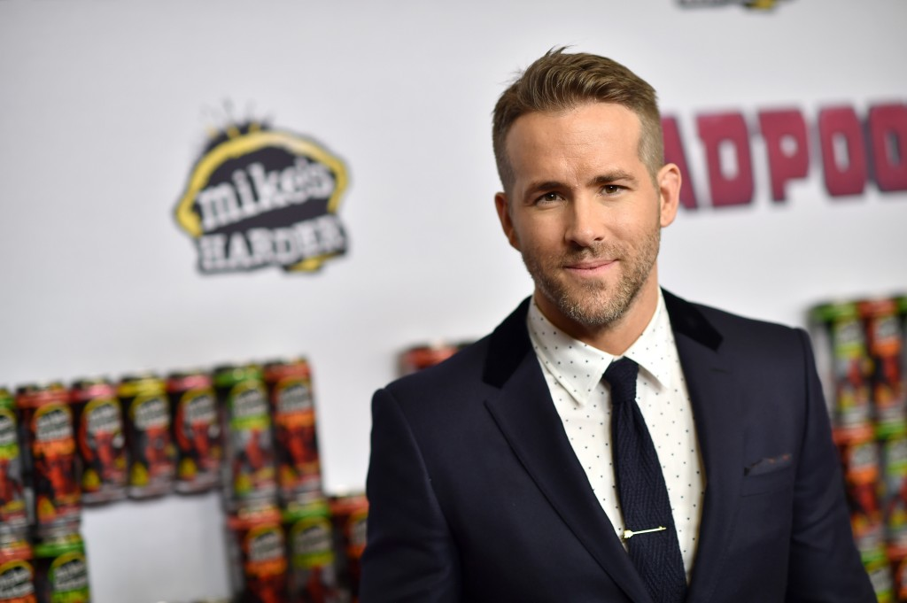 Ryan Reynolds is in a black suit while on the red carpet.