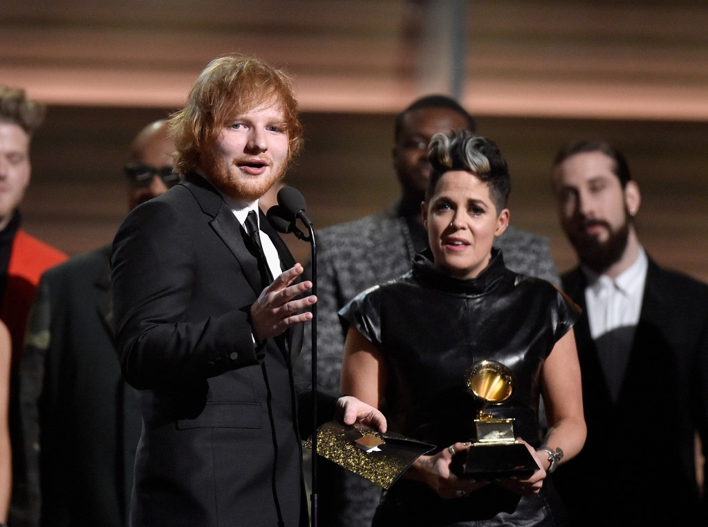 Musician Ed Sheeran stands among celebrities