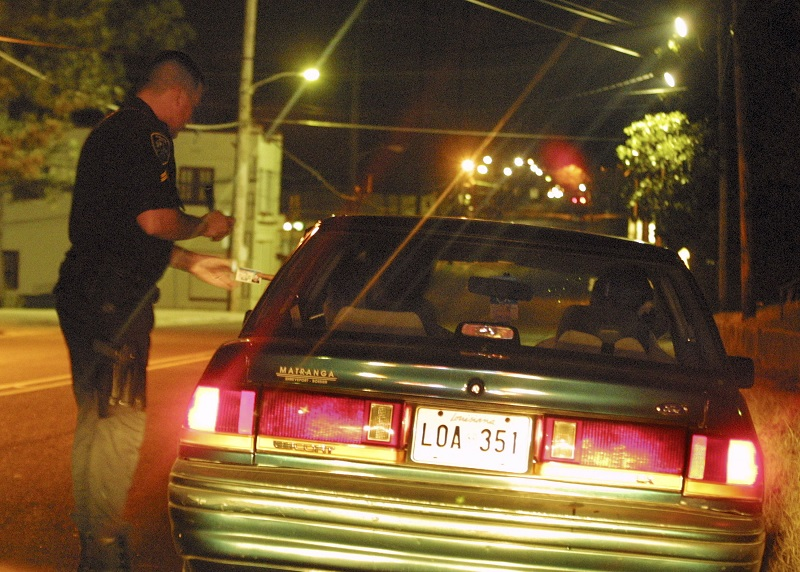 A police officer speaks to a driver during a traffic stop