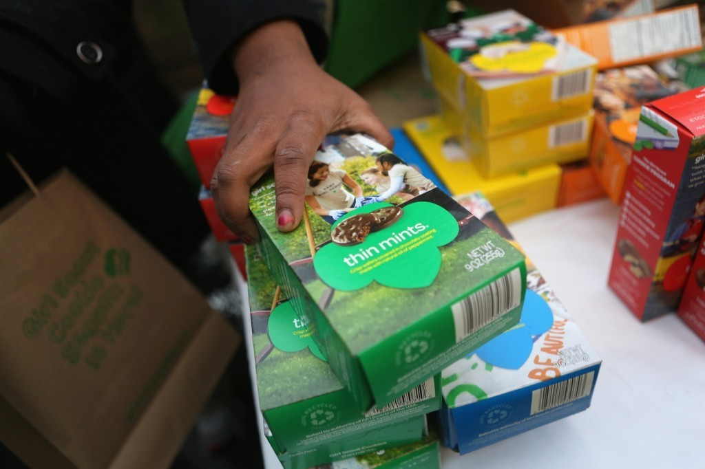 Person buying girl scout cookies
