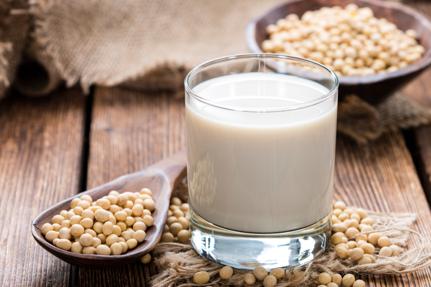 Glass of Soy Milk with seeds on wooden table