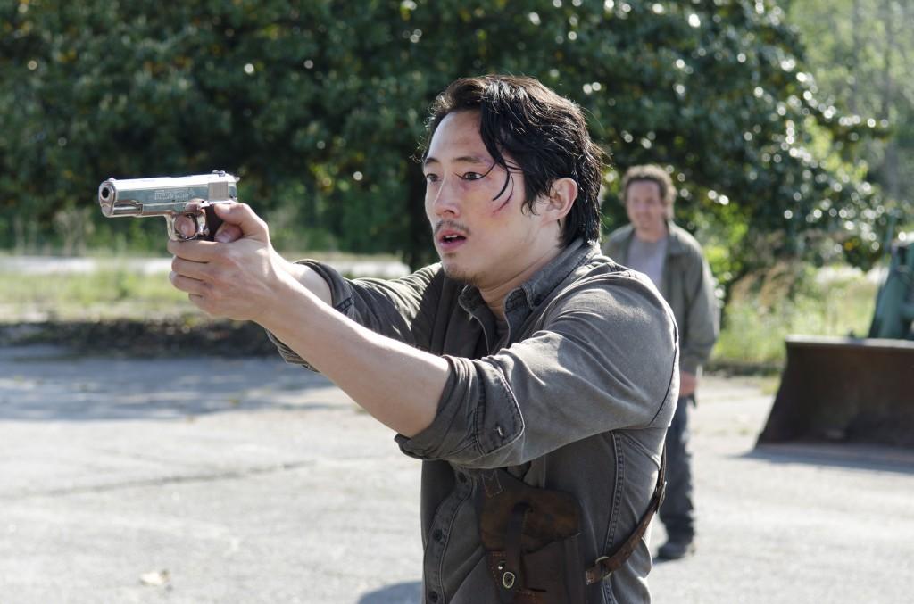 Glenn firing his gun to the left of the frame