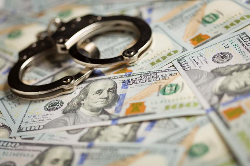 handcuffs on US dollars