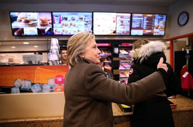 Democratic presidential candidate Hillary Clinton orders food at a Dunkin' Donuts on February 9, 2016 in Nashua, New Hampshire