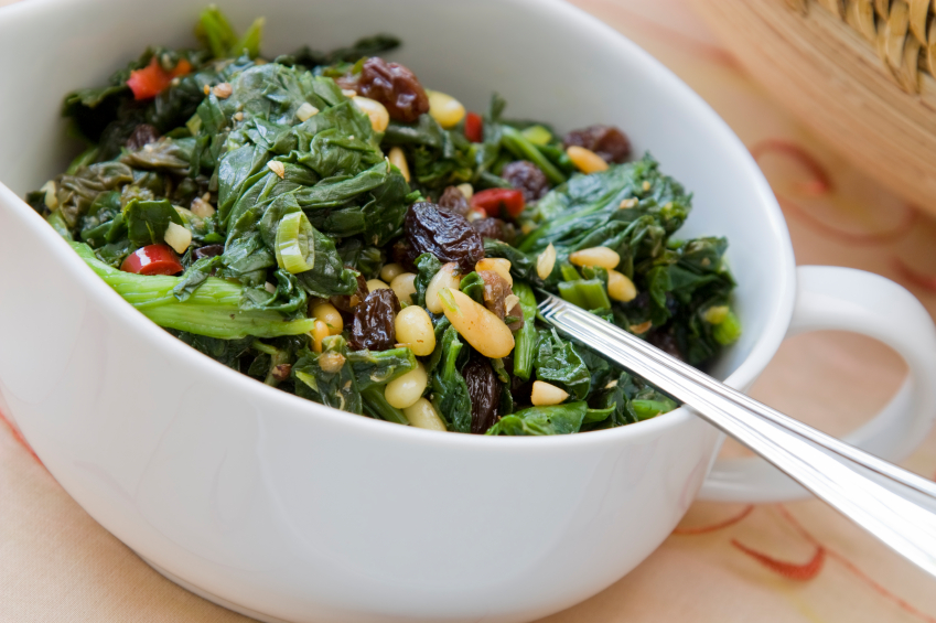 wilted spinach with dried fruit and nuts