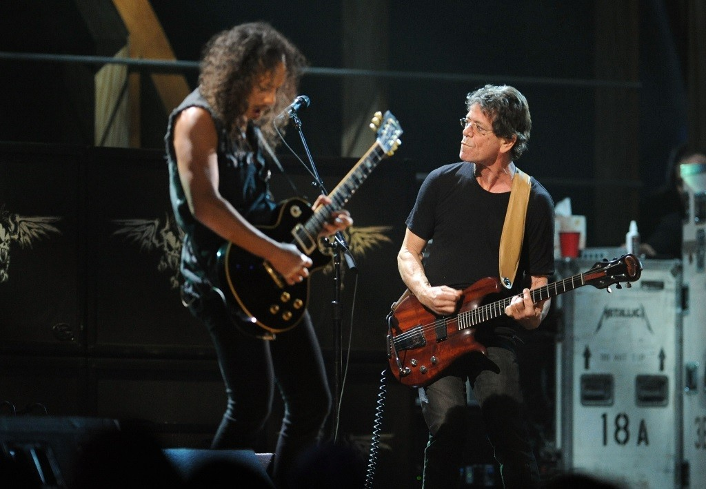 Kirk Hammett of Metallica with Lou Reed on stage playing the guitar