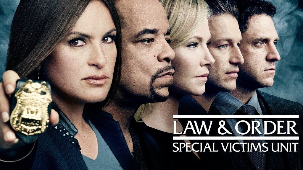 The cast of Law & Order: Special Victims Unit stands in a line