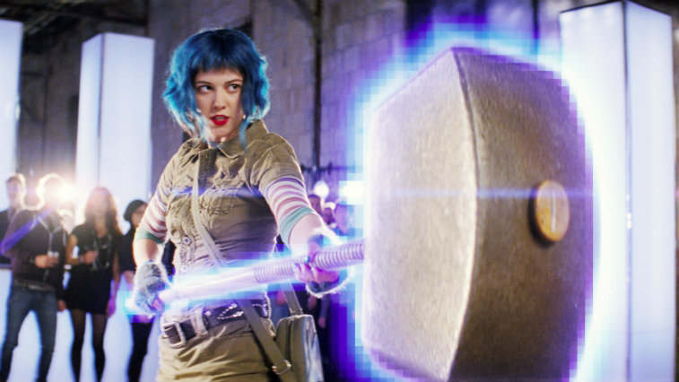 Mary Elizabeth Winstead with blue hair holding a giant hammer in a battle stance in Scott Pilgrim vs. the World