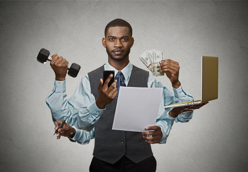 businessman showing multiple hands and arms to depict multitasking