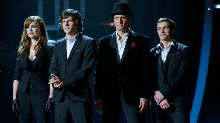 Isla Fisher, Jesse Eisenberg, Woody Harrelson, and Dave Franco on stage in dress clothes in 'Now You See Me'