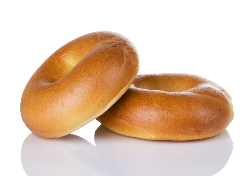 two plain bagels on a white surface