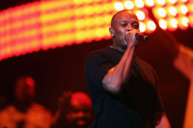 Dr. Dre holds up a microphone