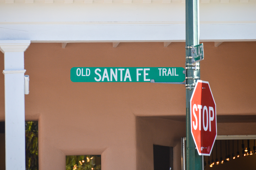 Stop sign in front of old Santa Fe trail