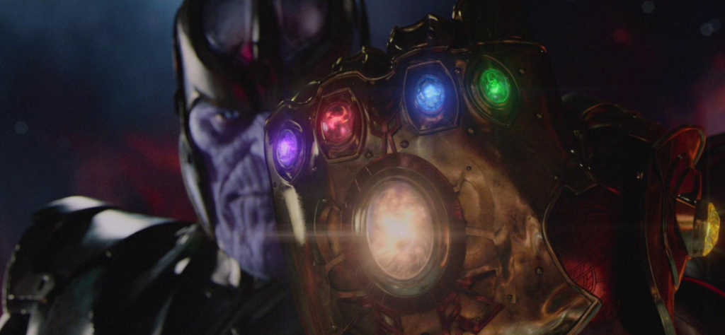 Thanos looking at the Infinity Guantlet with four stones in it