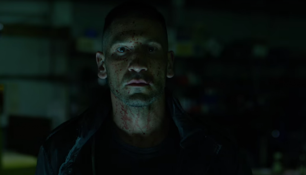 Actor Jon Bernthal's face splattered with blood as he stares into the camera