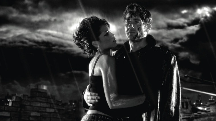 Rosario Dawson and Clive Owen in Sin City