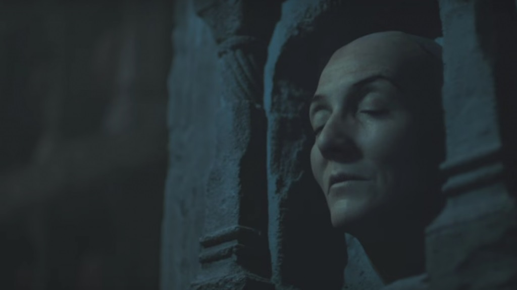 The face of Lady Catelyn Stark, displayed in a stone wall