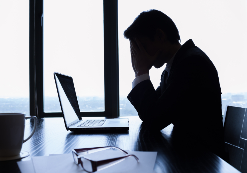 Stressed business man in front of a laptop