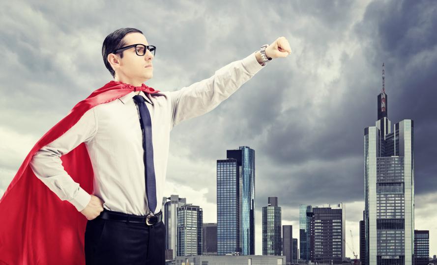 Superhero standing In front of a dark city
