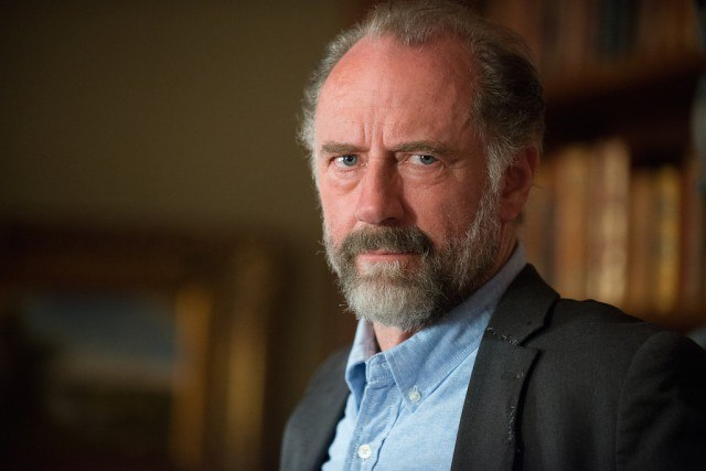 Gregory looks stern in a scene from 'The Walking Dead'