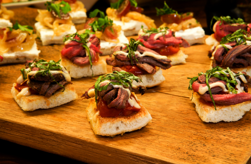 open-face sandwiches with roast beef tenderloin and microgreens