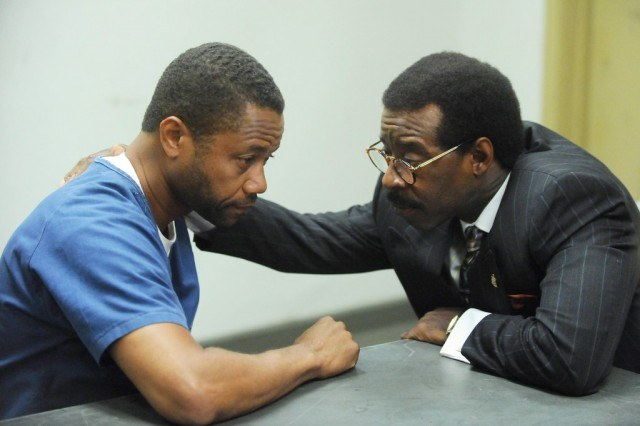 OJ (Cuba Gooding Jr.) and Johnny Cochrane (Courtney B. Vance) confer in jail during a scene from 'American Crime Story: The People v OJ Simpson'
