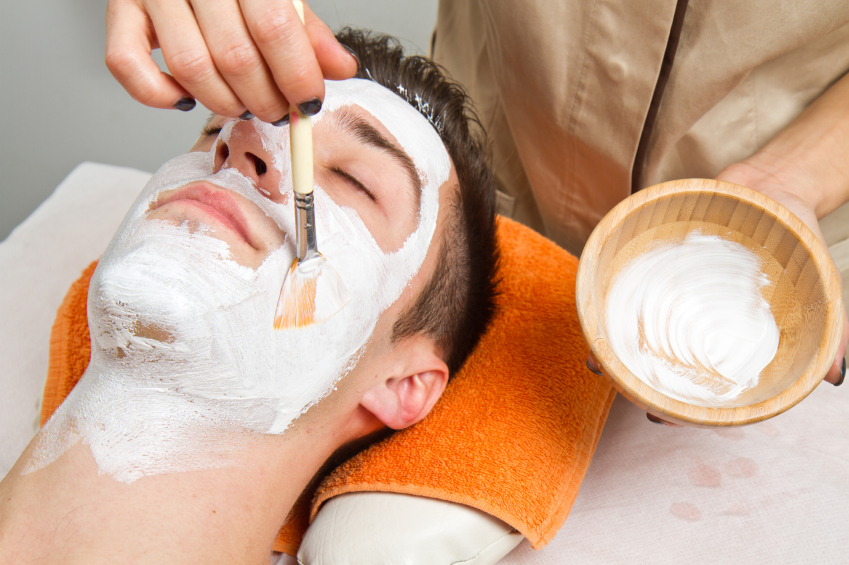 young man in spa having cosmetic face mask