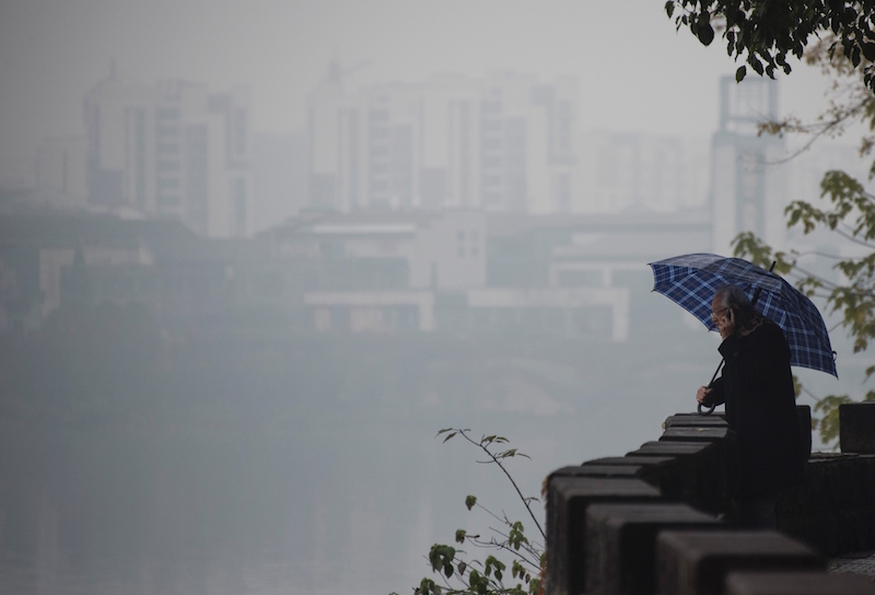 a man holds an umbrella in China