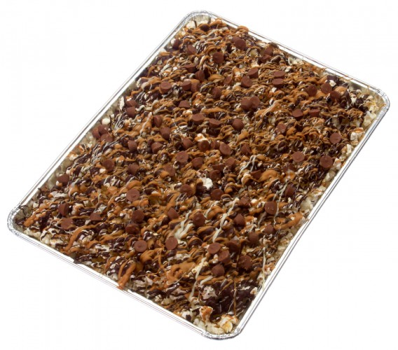 sheetray of popcorn smothered in candy, caramel, and chocolate
