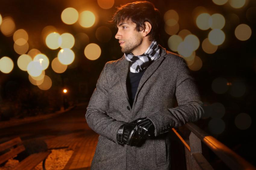 young man wearing long winter coat
