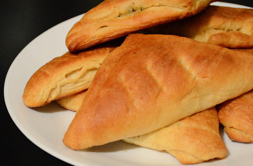 plate of cheesy spinach pockets